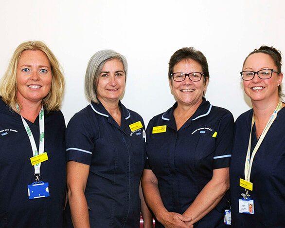 Four nurses standing proud on Bramble ward